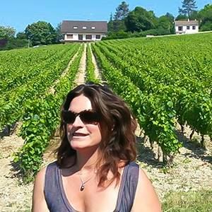 Marie Tesson in vineyard founder of Exclusive France Tours