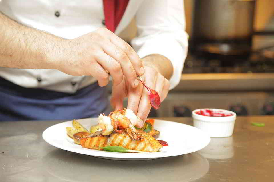 A Chef arranging his plate