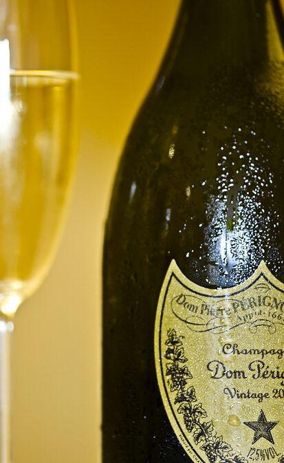 dom perignon vintage 2000 champagne bottle with glasses