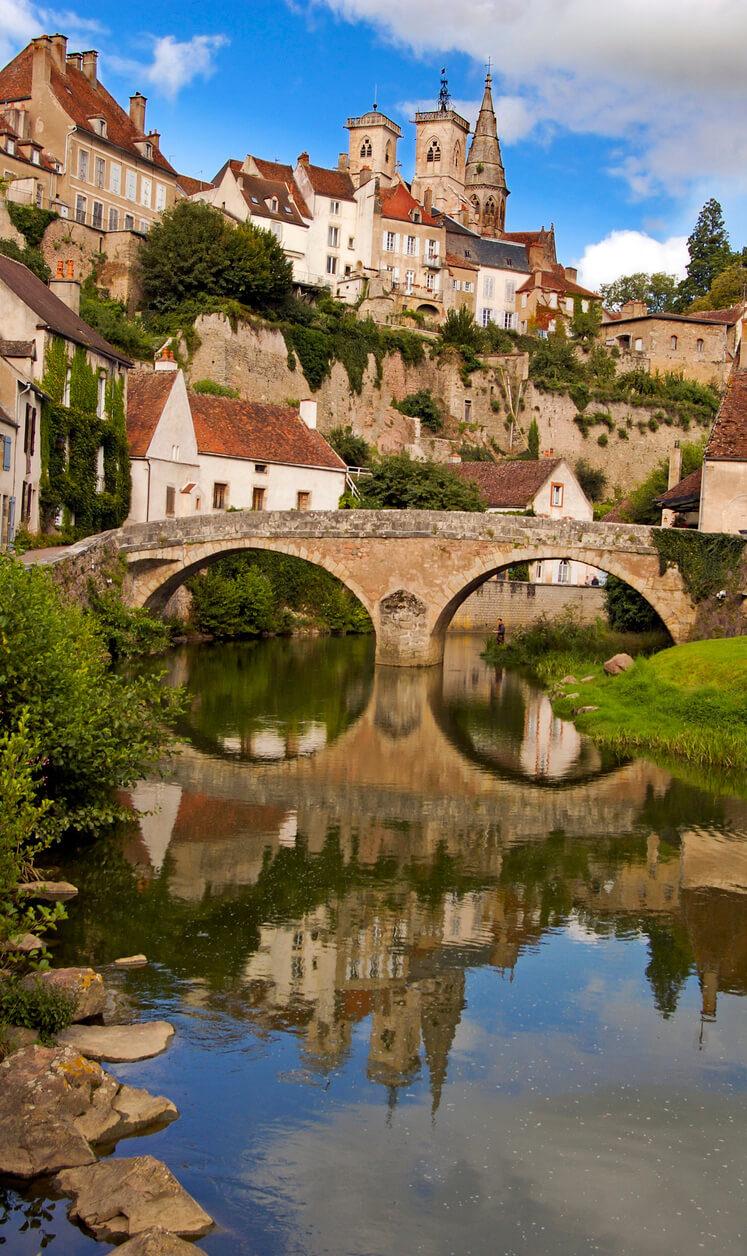 burgundy town on rocks river bridge